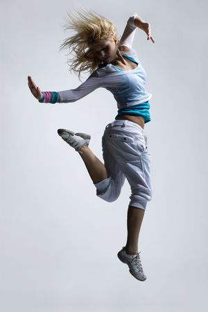 stylish and cool looking breakdancer jumping photo