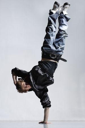 breakdance: stylish and cool breakdance style dancer posing