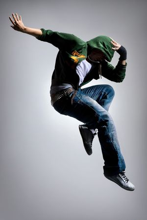 stunts: cool looking dancer makes a difficult jump