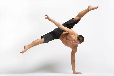 male dancer: modern ballet dancer posing over white background