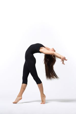 young modern ballet dancer posing on white background photo