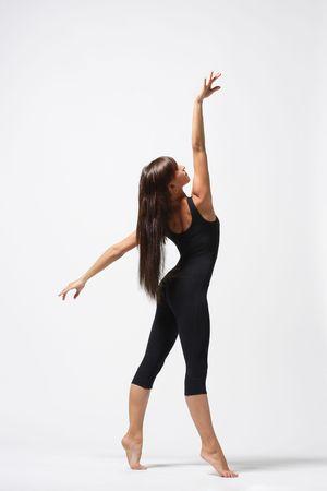 turnanzug: Young Modern Ballett�nzerin posiert auf wei�em Hintergrund Lizenzfreie Bilder
