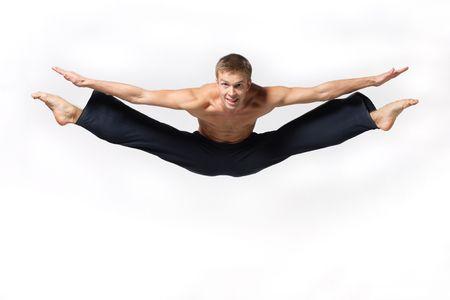 modern ballet dancer posing over white background
