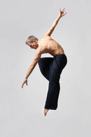 ballet: modern ballet dancer posing over white background