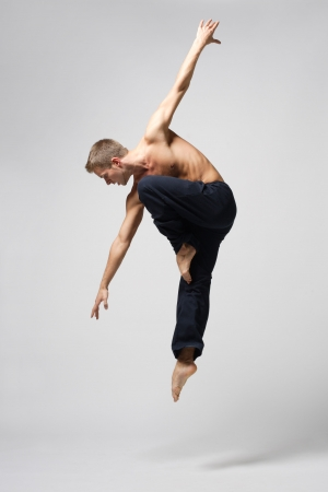 modern ballet dancer: modern ballet dancer posing over white background