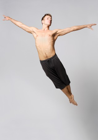 young and stylish modern ballet dancer jumping on Stock Photo - 3944332