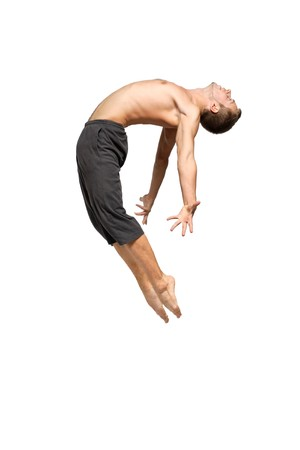 modern ballet dancer: young and stylish modern ballet dancer jumping on Stock Photo