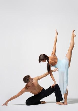two modern ballet dancers posing on white Stock Photo