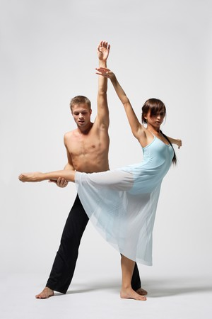 two modern ballet dancers posing on white Stock Photo