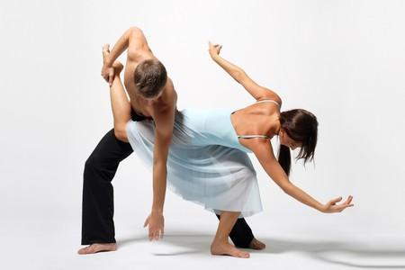 tangoing: two modern ballet dancers posing on white Stock Photo