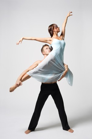 two modern ballet dancers posing on white photo