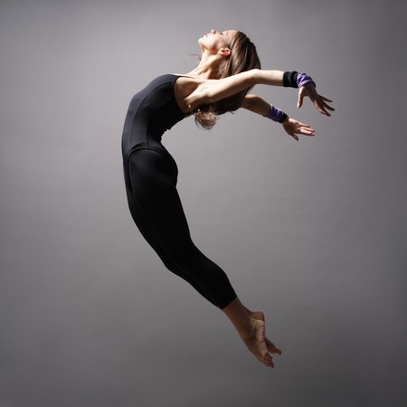 leap: young modern style dancer posing