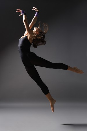ballerina girl: stylish and young modern style dancer is posing