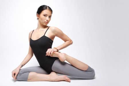 young yoga female doing yogatic exericise Stock Photo