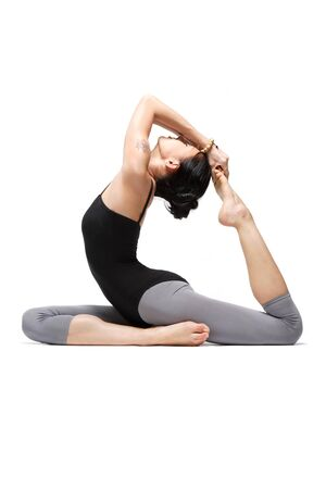 young yoga female doing yogatic exericise photo