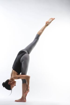 young yoga female doing yogatic exericise photo