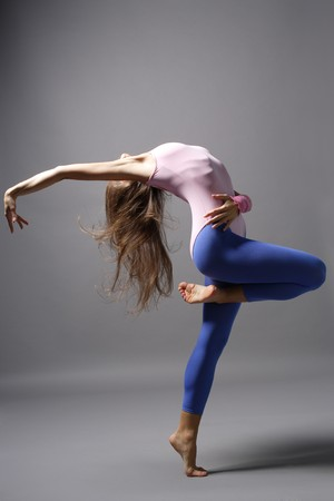 stylish and young modern style dancer is posing photo