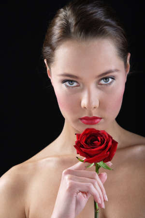 portrait of young woman with rose photo