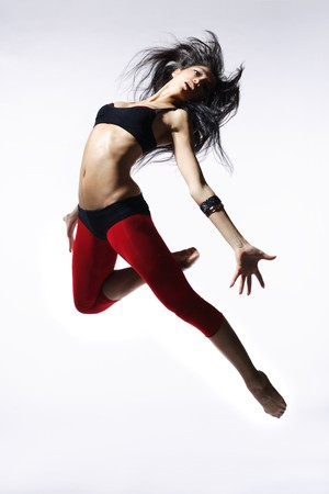 acrobat: stylish and young modern style dancer is posing