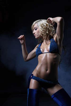 nightclub go-go style dancer is posing Stock Photo