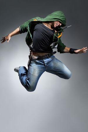 modern style dancer posing behind studio background Stock Photo