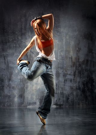 break dancing: modern style dancer posing behind studio background Stock Photo
