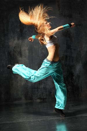break dancer: modern style dancer posing behind studio background Stock Photo