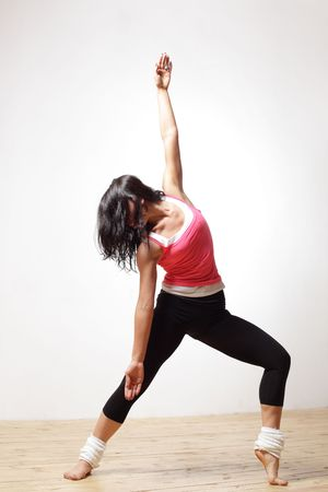 contemporary dance: modern style dancer posing on studio background
