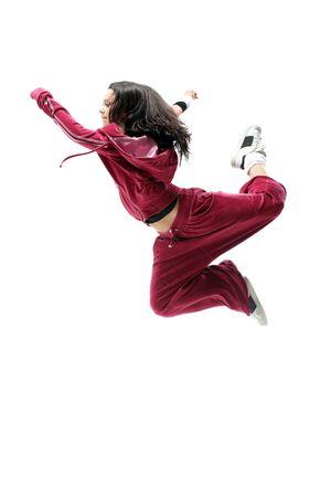 hop: modern style dancer posing on studio background