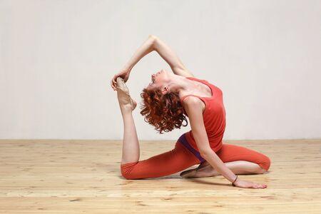 modern style yoga female posing on studio background photo