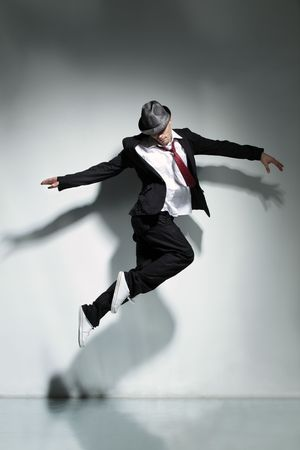 modern style dancer jumping on studio background photo
