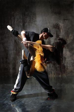 modern style dancer posing on dirty grunge background photo