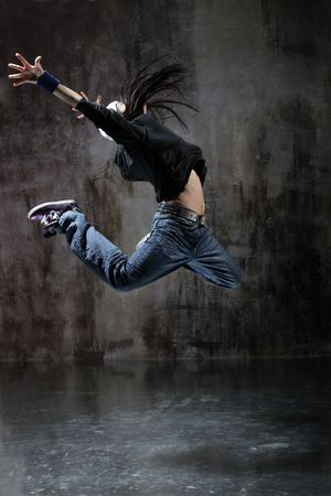 raps: modern style dancer jumping on dirty grunge background