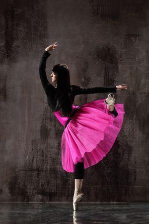 modern style dancer posing on dirty grunge background Stock Photo - 5226065