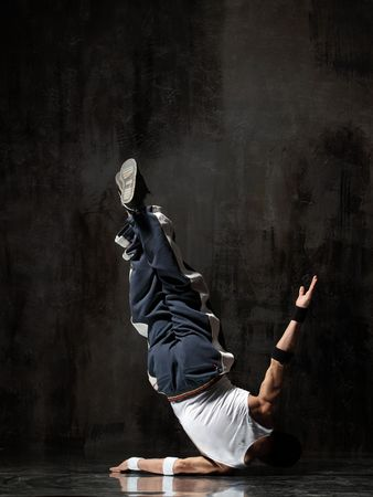 modern style dancer posing on dirty grunge background Stock Photo - 5226042