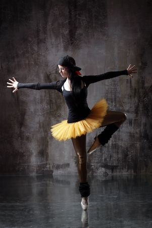 modern style dancer posing on dirty grunge background Stock Photo - 5226013