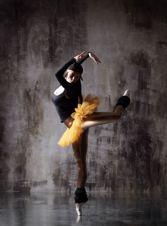 modern style dancer posing on dirty grunge background photo