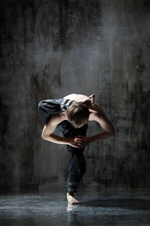 cool yoga man posing on dirty grunge background photo