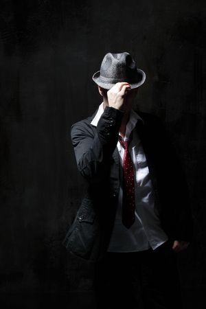 hat nude: modern style dancer posing on dirty grunge background