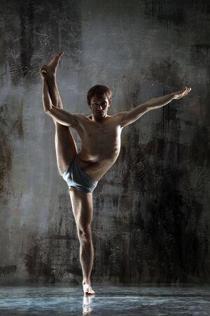 cool yoga man posing on dirty grunge background photo