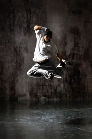 modern dancer poses in front of the old dirty wall Stock Photo - 5439127