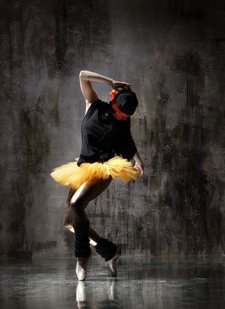 modern dancer poses in front of the old dirty wall Stock Photo - 5439131