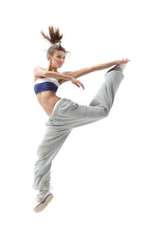 fitness danse: danseuse contemporaine pose devant le mur blanc Banque d'images