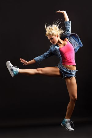 modern dancer poses in front of the black wall Stock Photo - 5826697