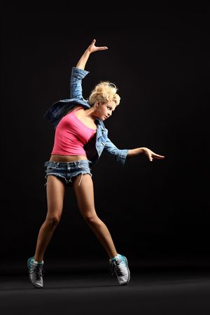 breakdancer: cool dancer poses in front of the black background