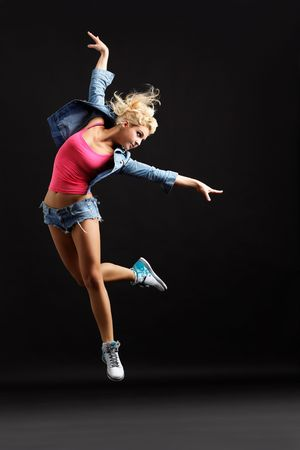 modern girl: modern dancer poses in front of the black wall
