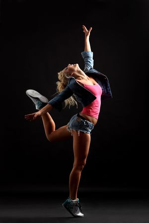 modern dancer poses in front of the black wall photo