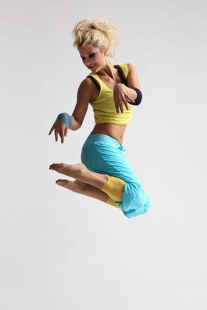 cool dancer poses in front of the light gray background photo