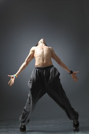 modern dancer poses in front of the gray background photo