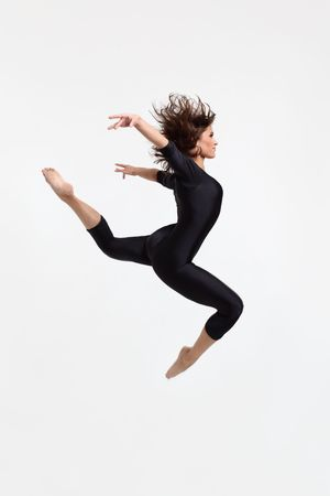 modern dancers poses in front of the white background photo